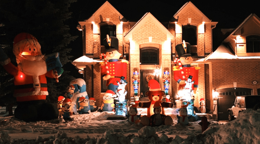 christmas inflatables impressive display including two story nutcrackers and santa on well lit home
