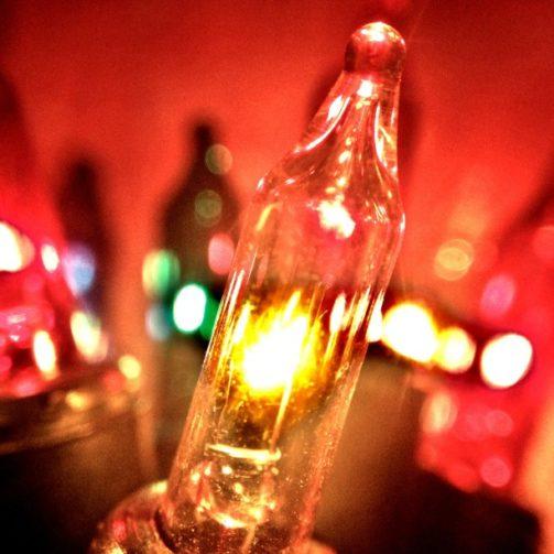 closeup incandescent christmas light bulbs