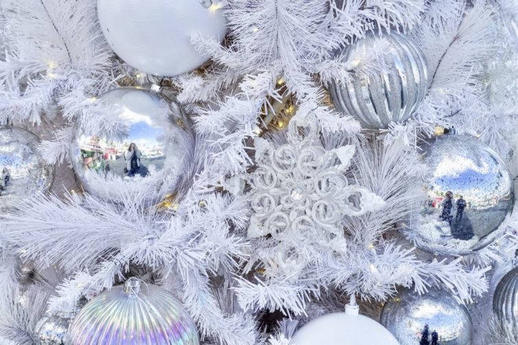 closeup of all white and silver tree decorated for the holidays