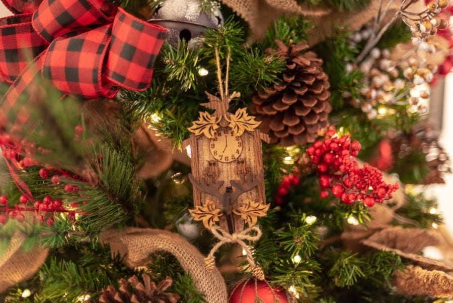 rustic miniature wooden cuckoo clock hanging on the Christmas tree