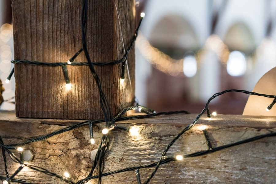 closeup of wood with string lights on it