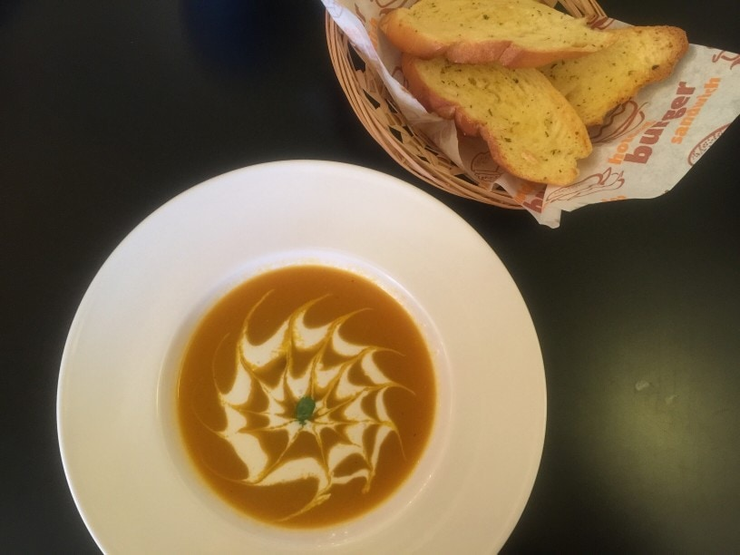 creamy root vegetable soup with garlic bread