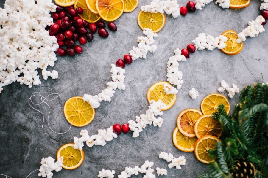 Holiday Christmas Flat Lay garland of cranberry popcorn dried oranges citrus rustic natural