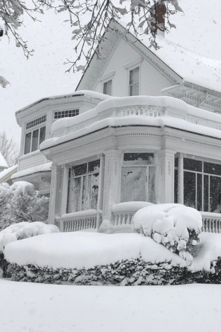 queen anne gabled roof with snow