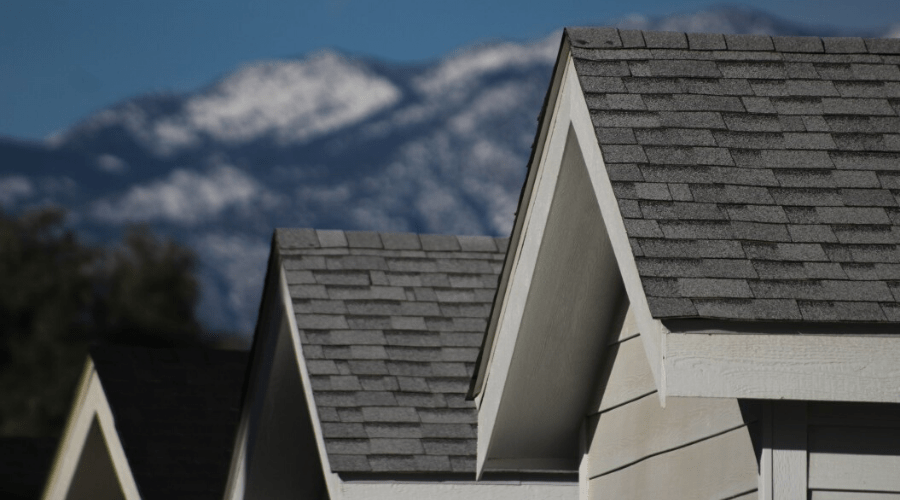 shingled rooftops with mountain background