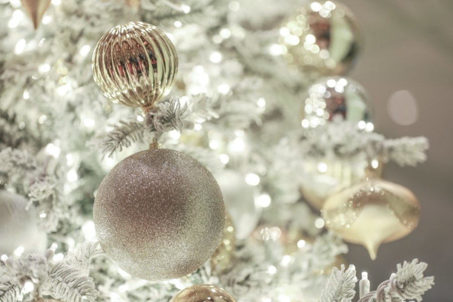 White Christmas tree with elegant gold and silver ornaments glitter, glossy, shiny,