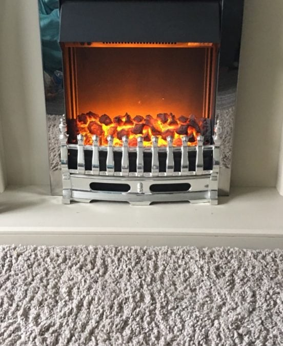 Lovely living room heater, chrome with lots of Orange Coals burning bright creating soft glow