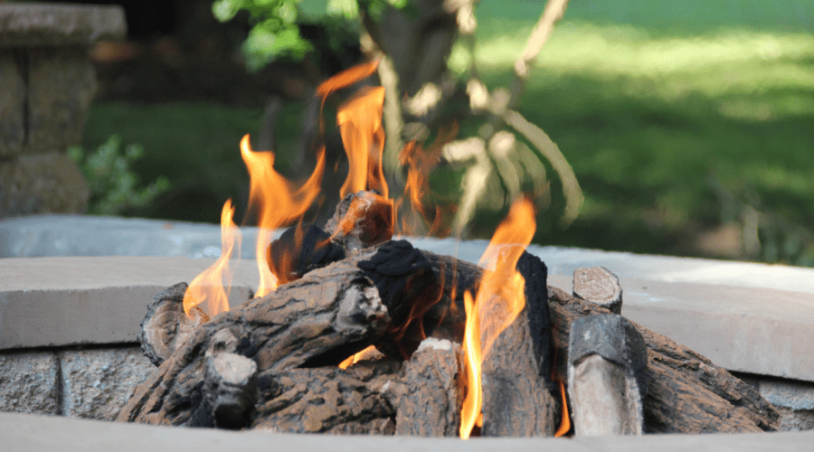 many types of firewood outdoor firepit burning daytime