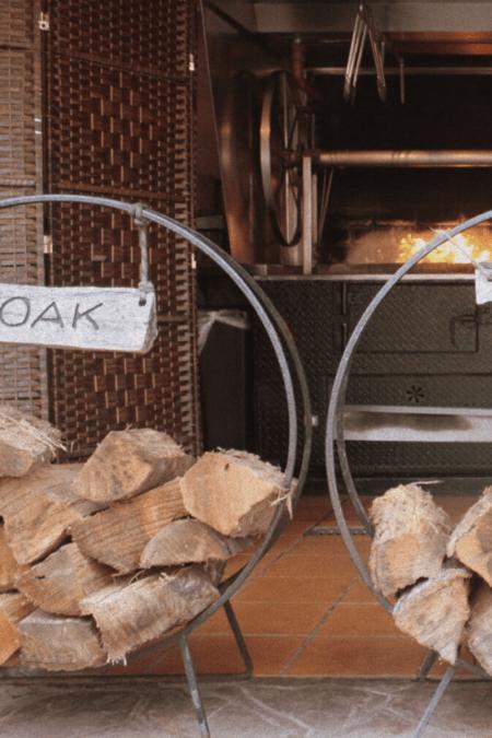 seasoned oak forewood in circular rack indoors