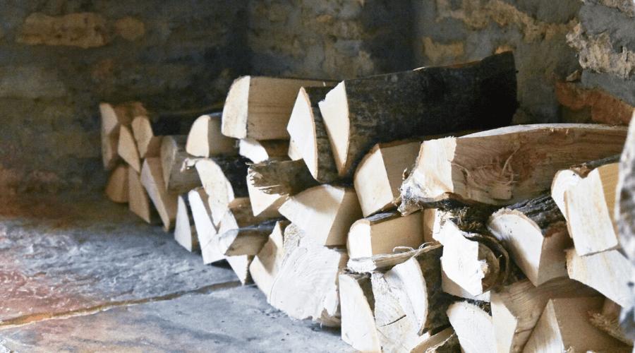 oak firewood guide wide stacked in hearth