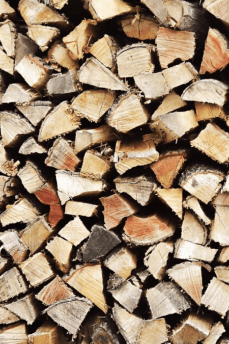 processed seasoning firewood tall split logs from end