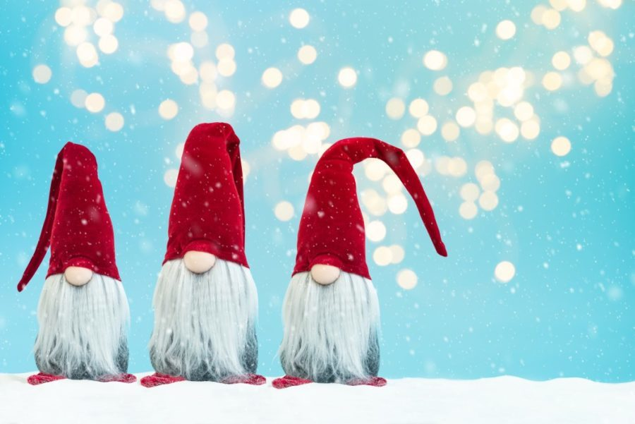 three tomte traditional christmas noel gnomes on blue background