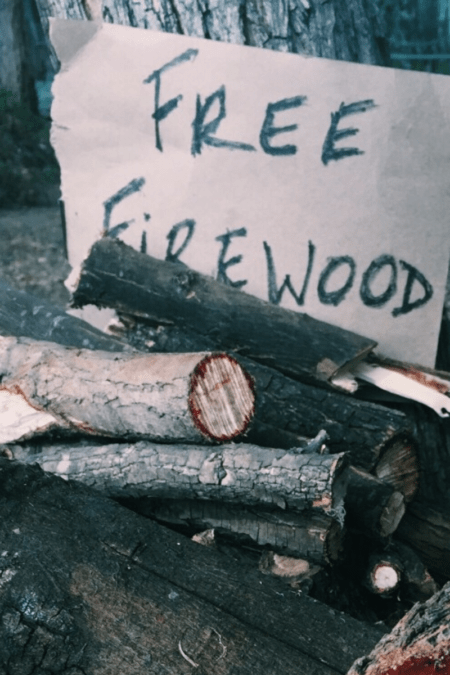 where to buy firewood tall free firewood sign posted near stack of logs