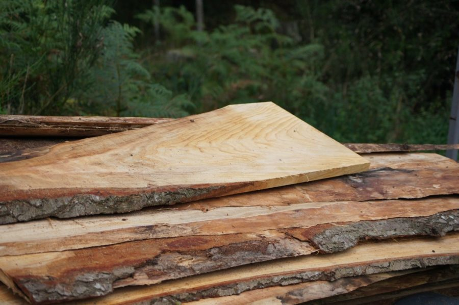 Live-edge cedar shingles stacked wood