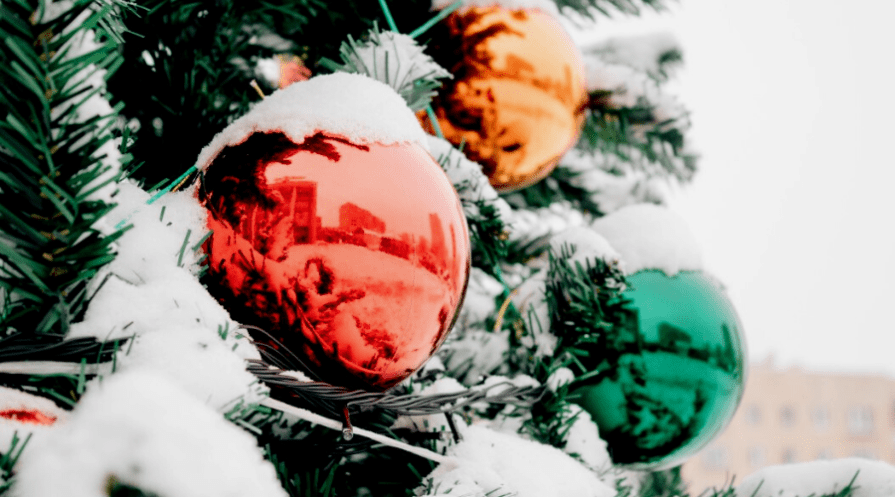 closeup and reflection of colorful christmas xmas tree large outdoor ornaments