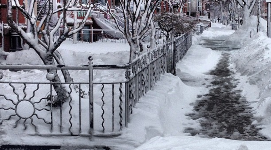 Magnesium Chloride vs. Calcium Chloride Ice Melt wide a city street residentail with snowy icy sidewalks snow weather