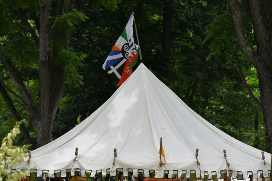 A tent with banners at a Renaissance Fair Faire, make believe, historical - - copy space, background, commercial clearance