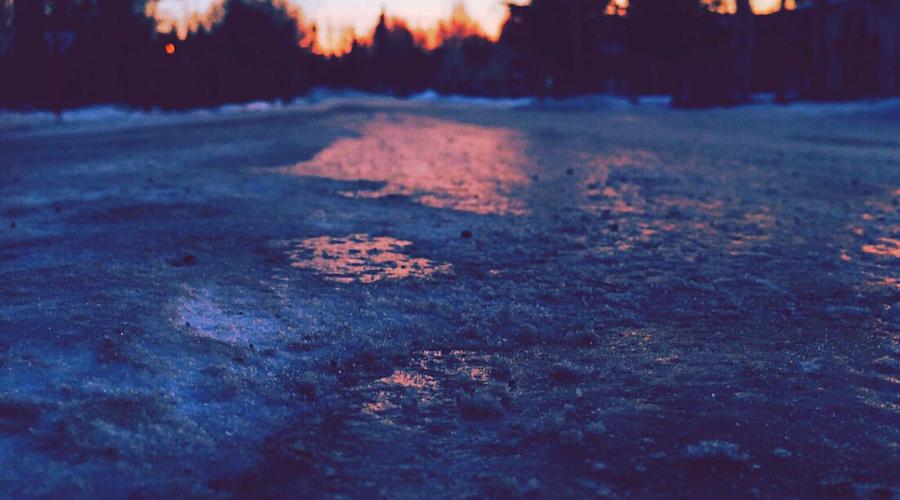 beet juice ice melt wide icy road dusk
