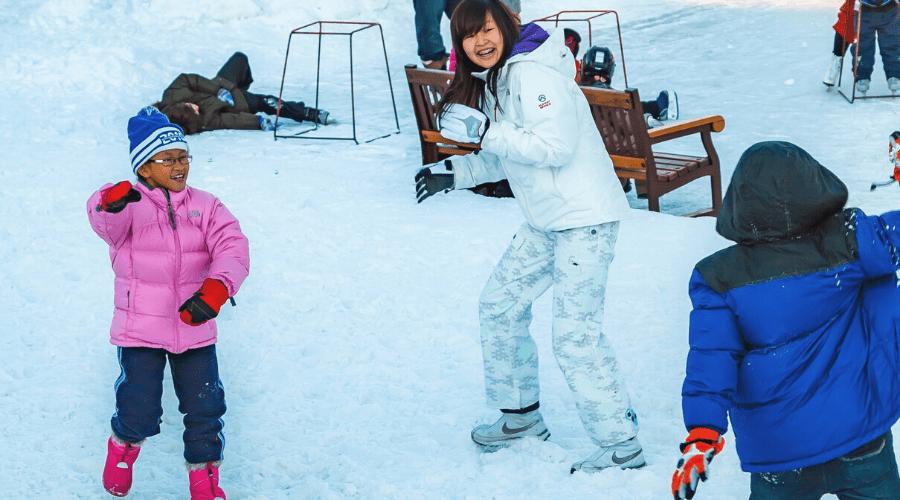 kids having a snowball fight outdoors winter snowball maker