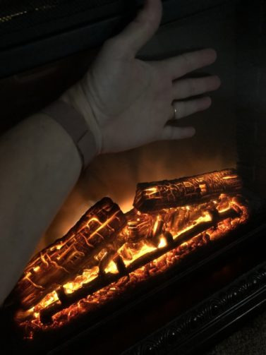 Electric fireplace / hand in frame