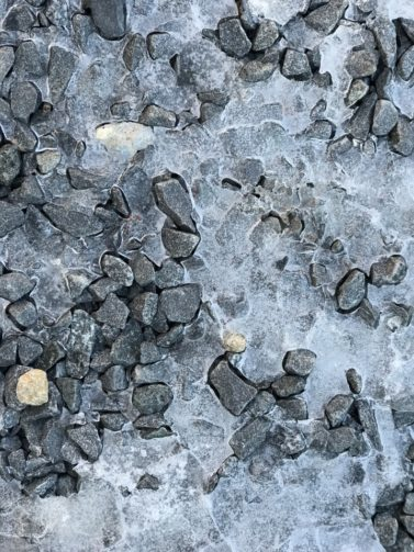 Icy driveway with ice melt