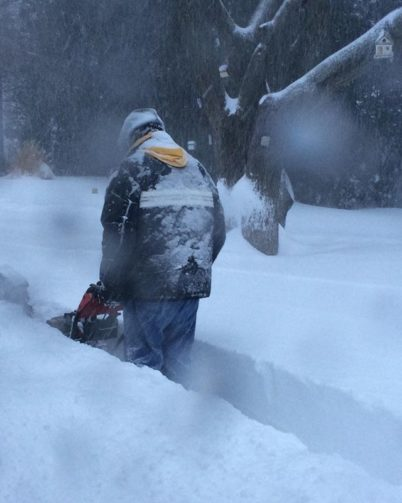 Man using snowblower, snow, nor'easter blizzard, men doing chores, wintertime
