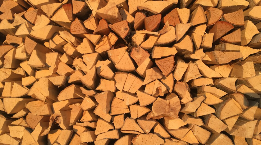 a stack of split pinewood drying pine for firewood