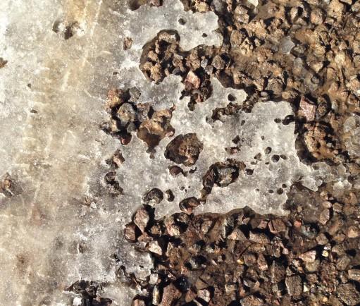 frozen gravel under ice driveway snowblower