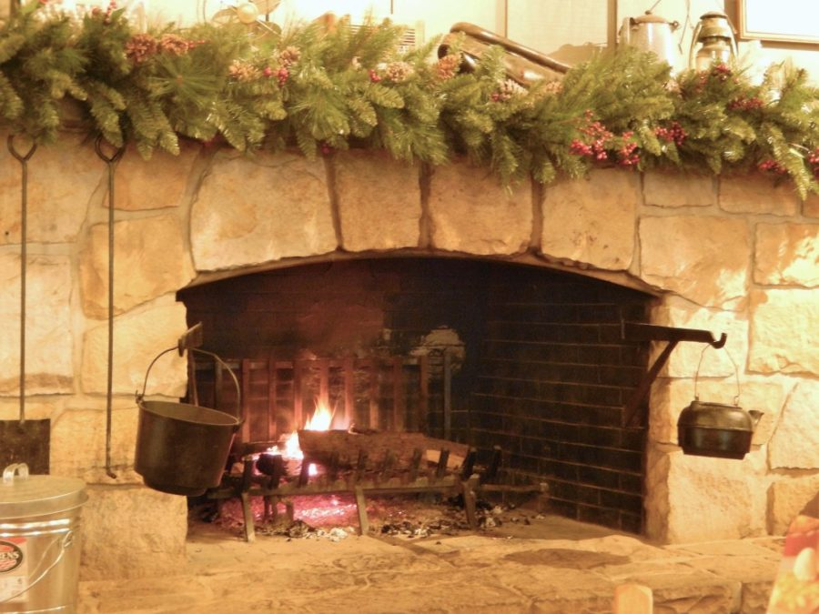 woodfire burning indoor fireplace decorated for christmas