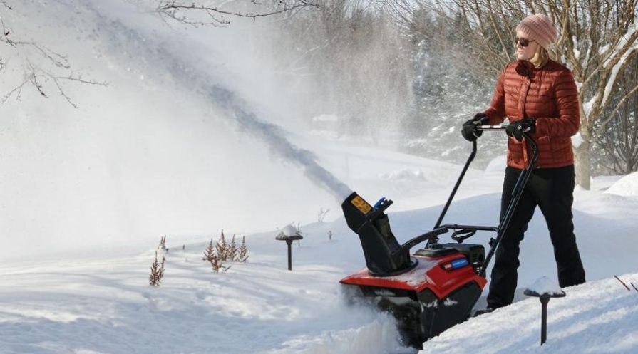 Commercial grade Toro snow blower operated by a woman.
