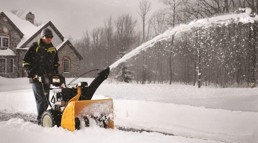 Man clearing snow with a Cub Cadet snow blower