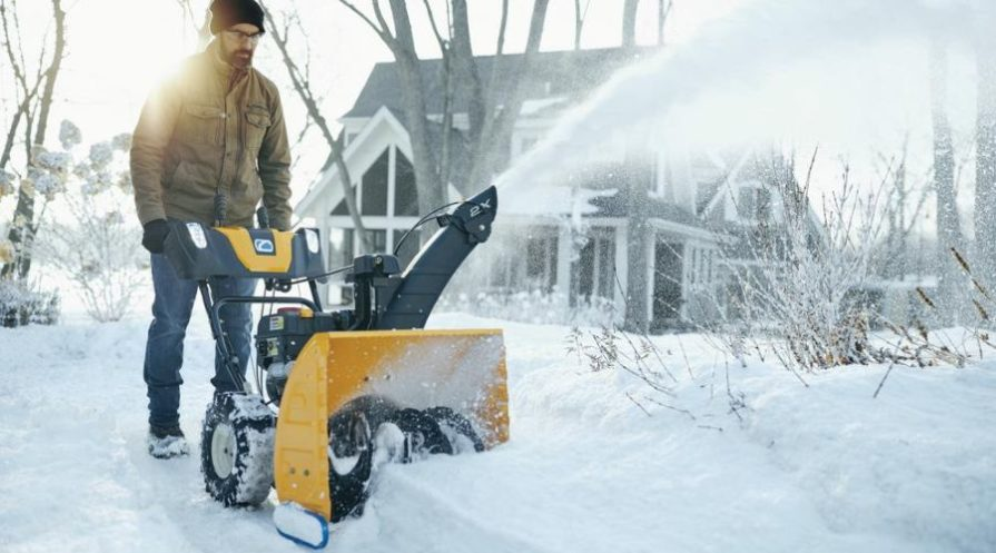Man clearing snow with a Cub Cadet 2X 24 inch snow blower