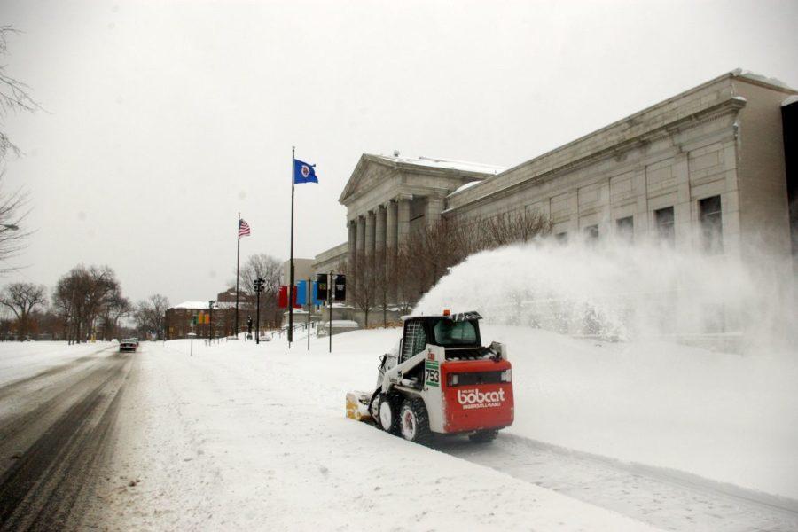 clearing wialk with skid steer snow blower Minneapolis Institute of Art, Minneapolis, Minnesota, USA