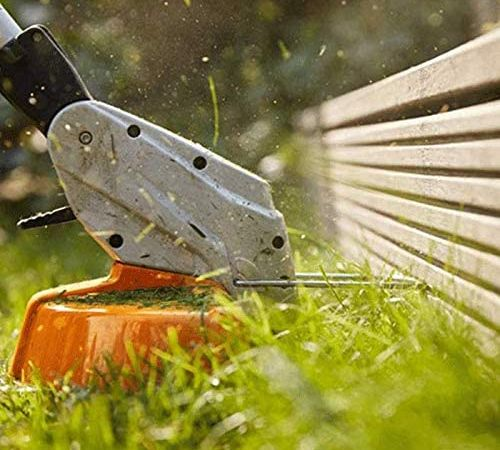 The cutting head of a Stihl weed eater in action.