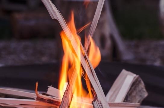 burning kindling indoor fireplace closeup
