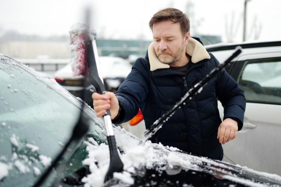 snow broom ice scraper in use