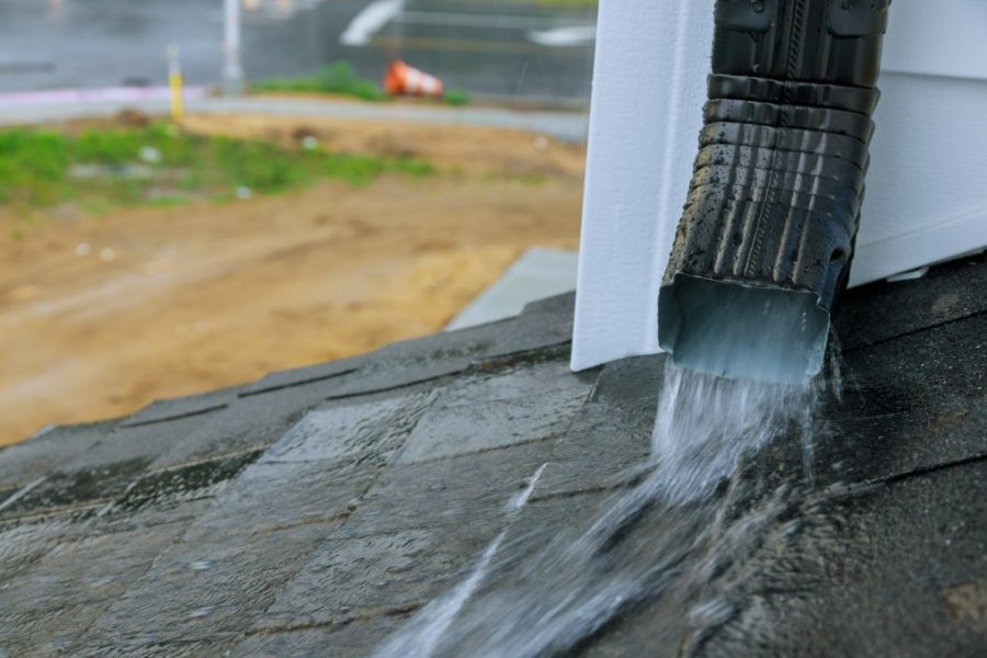 Heavy rain during the rainy season causing with water during heavy rain to flow down the roof clear water gutter guard no debris