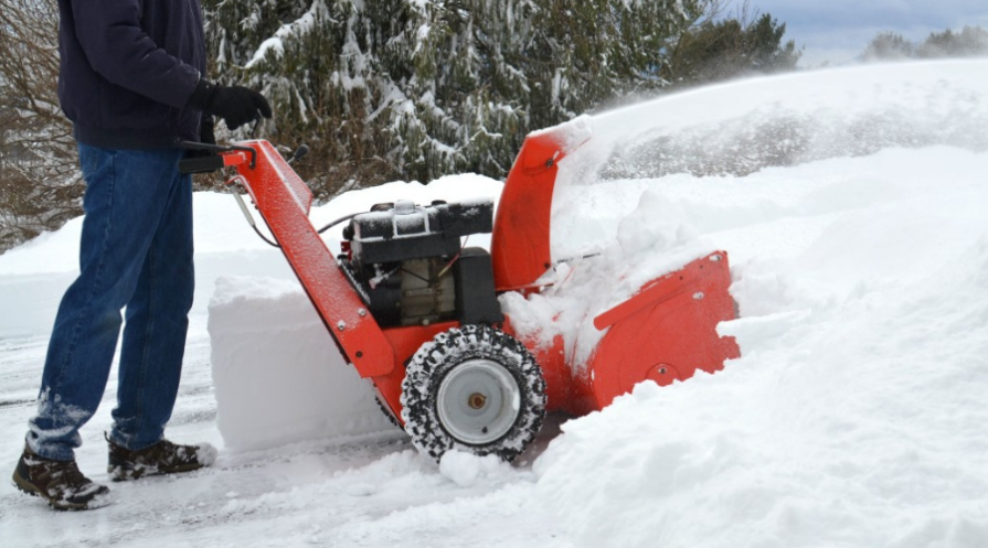 Clearing 2 feet of snow with a snowblower in the winter.