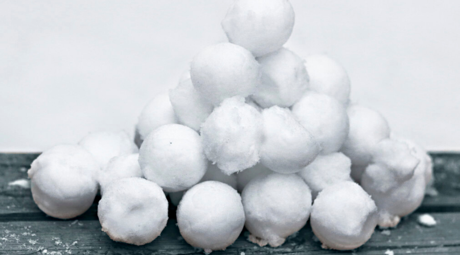 snowballs stacked and ready to launch outdoors in winter