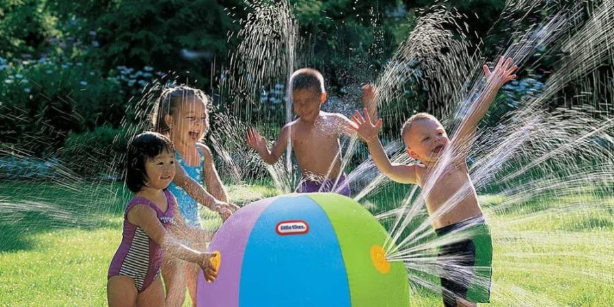 Kids playing with the Little Tikes Beach Ball sprinkler.