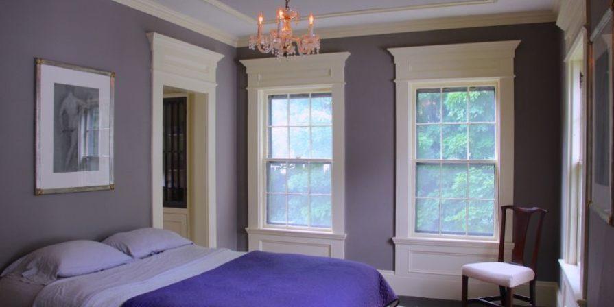 Bedroom with purple walls.
