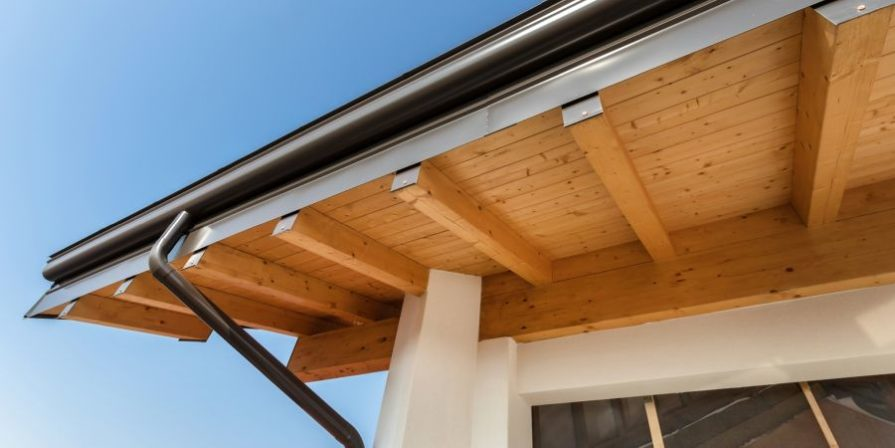 Rounded rain gutters seen from underneath on a new house