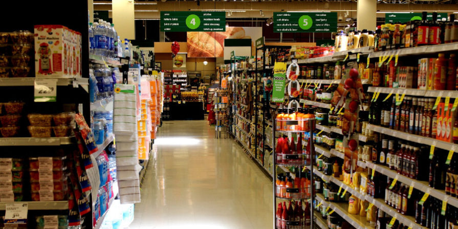 A grocery store aisle with canned food.