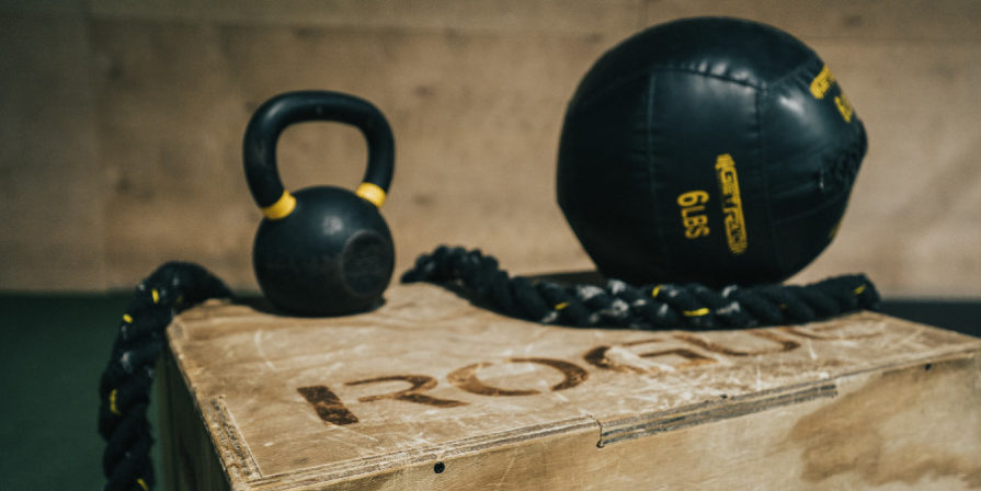 Medicine ball, kettlebell and ropes on a Crossfit style plyometric box