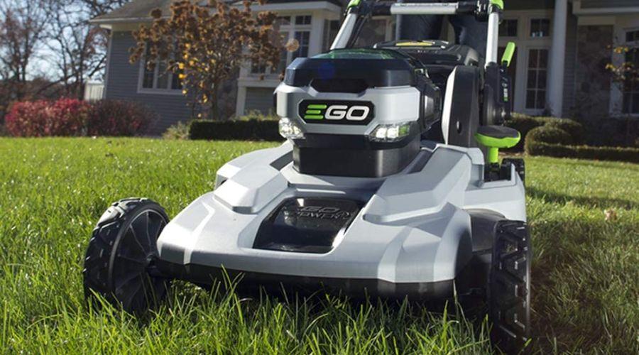 EGO Power+ lawn mower on a lawn outside a big houss.