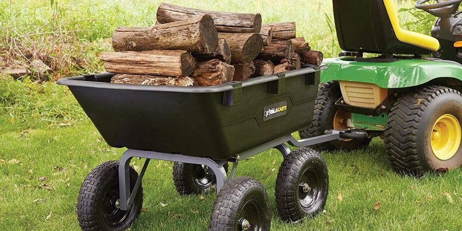 Gorilla Carts Poly Yard Dump cart loaded with logs, attached to an ATV.