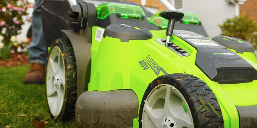 A Greenworks electric cordless twin force lawn mower doing its job.