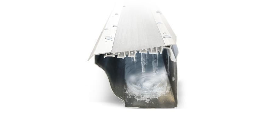 cross section of a LeafFilter gutter guard covering a gutter with water running through