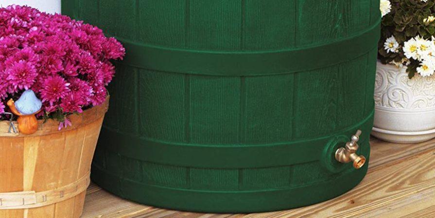 Brass spigot on a green Good Ideas rain barrel.
