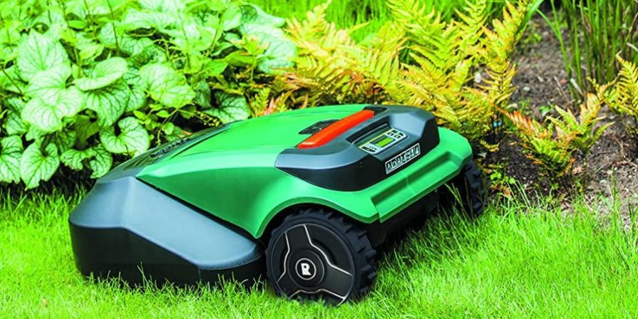 A Robowmow robotic lawn mower making its round along a flower bed.